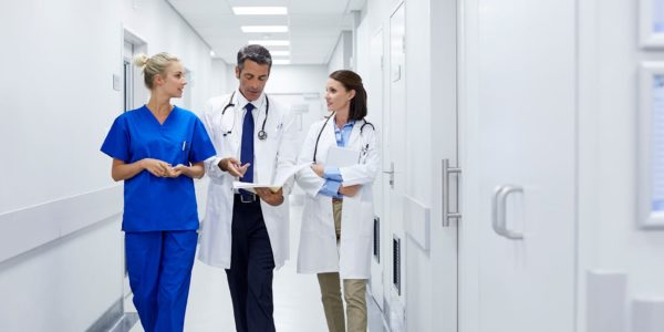 Doctors talking in a hallway